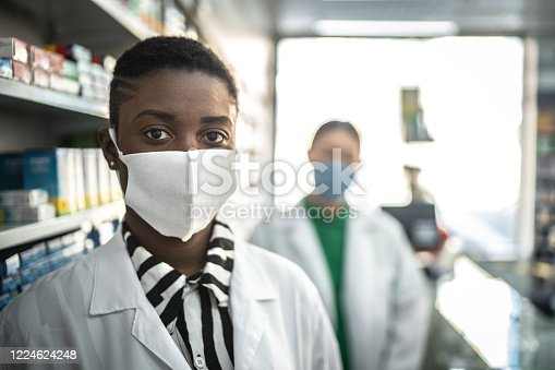 Portrait of coworkers pharmacists with face mask at pharmacy