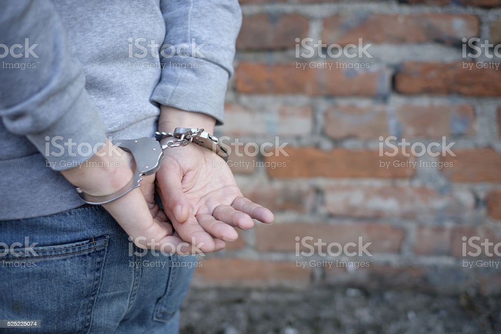 portrait of criminal man arrested stock photo