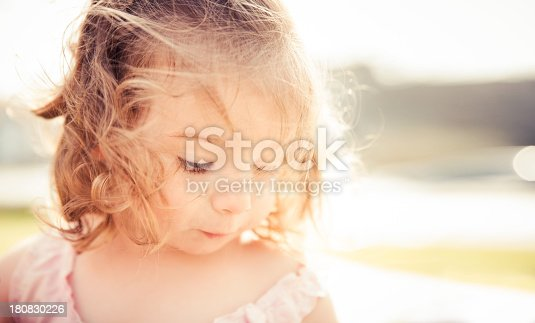 istock Portrait of curious girl on a sunny day 180830226