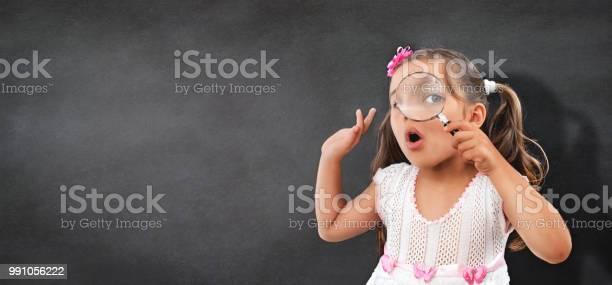 Portrait of curious little child girl looking through magnifying picture id991056222?b=1&k=6&m=991056222&s=612x612&h=o8tjfs7l2lftgk pbl5bkizskkc1fc ooldi5y5p1kw=