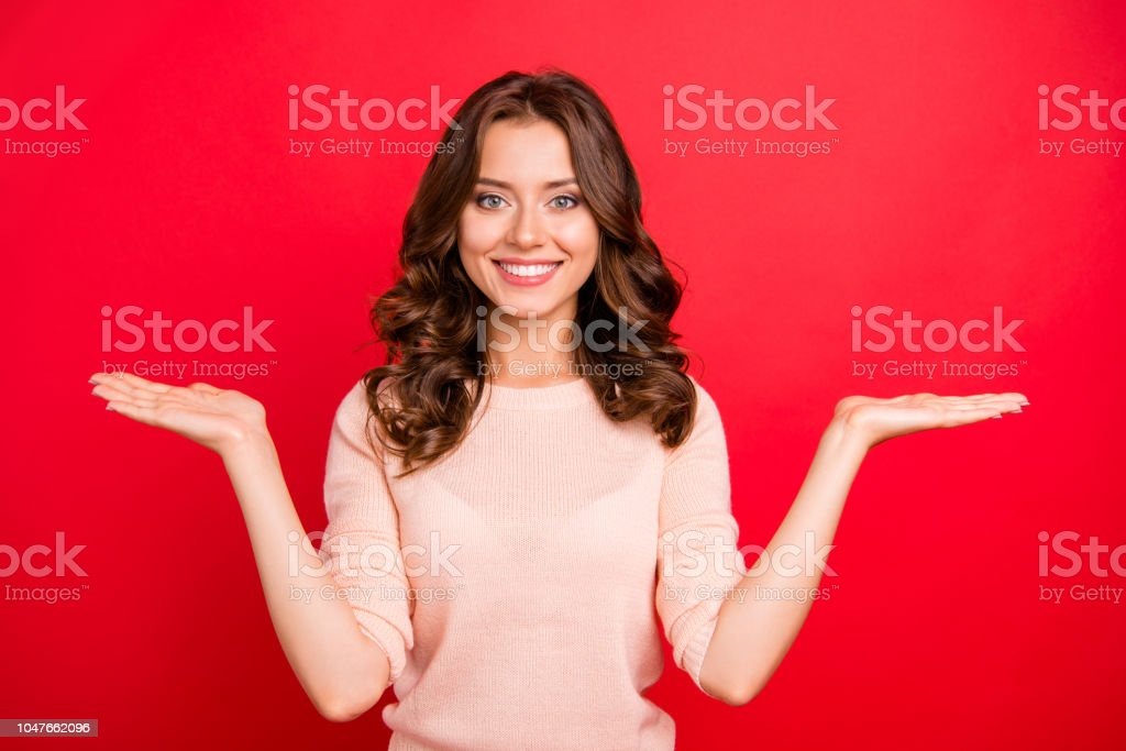 Portrait Of Curly Woman Hold Invisible Object Or Product On Raised