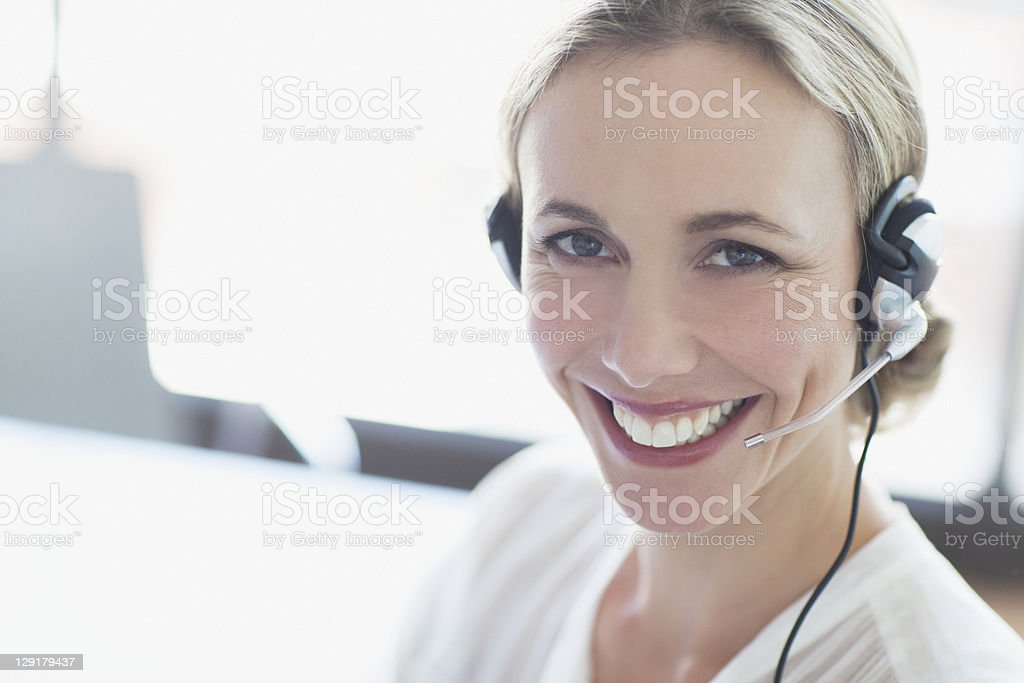 Portrait of customer service representative smiling royalty-free stock photo