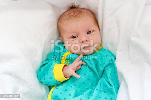 508167718istockphoto Portrait of cute adorable newborn baby child 639489062