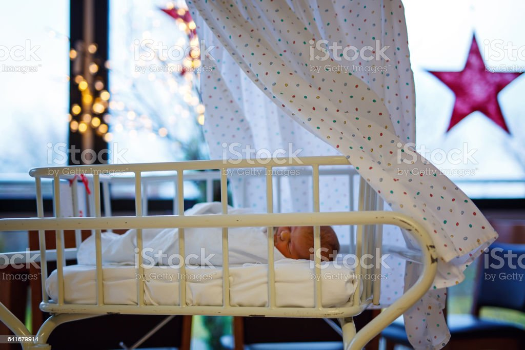 Portrait of cute adorable newborn baby girl in birth hospital. stock photo