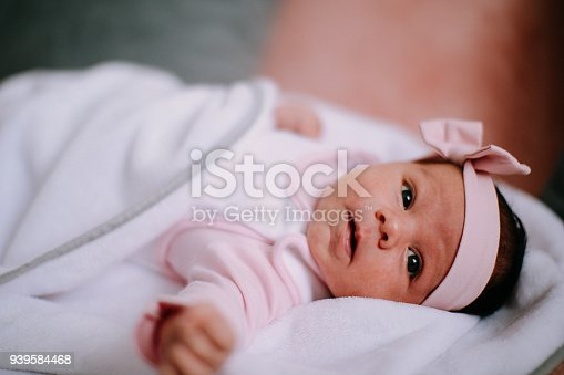 508167718 istock photo Portrait of cute adorable newborn baby girl 939584468