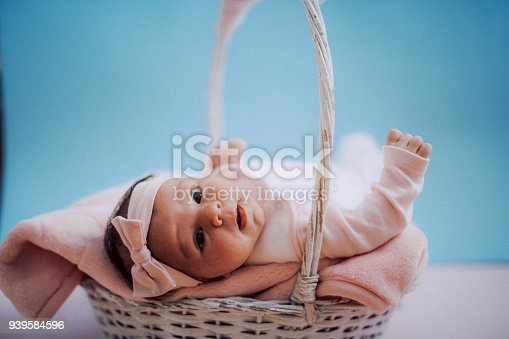 508167718 istock photo Portrait of cute adorable newborn baby girl 939584596
