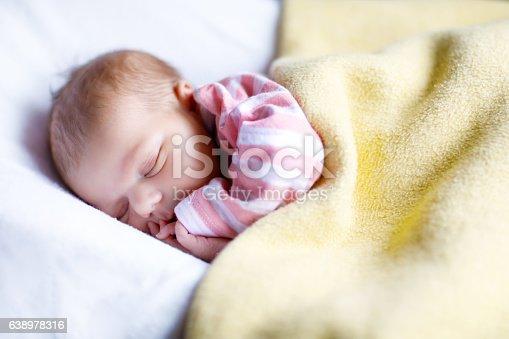 istock Portrait of cute adorable newborn baby girl sleeping 638978316