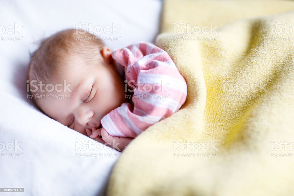 Portrait of cute adorable newborn baby girl sleeping stock photo