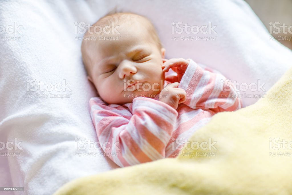 Portrait of cute adorable newborn baby girl sleeping royalty free stock photo