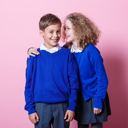 Portrait Of Cute And Happy Schoolboy And Schoolgirl Stock Photo - Download Image Now