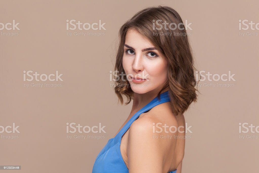 Portrait of cute and sensual young welldressed woman stock photo