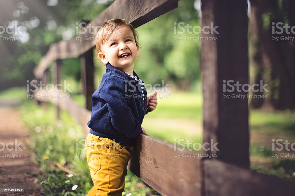 Portrait of cute baby boy laughing stock photo
