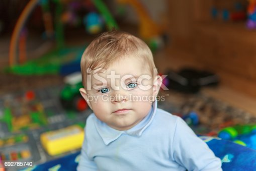 508167718 istock photo Portrait of cute baby boy of 6 months at home. 692785740