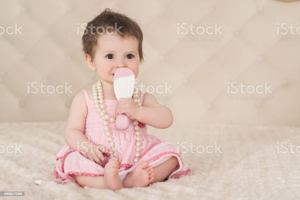 portrait of cute baby girl in pink dress, with pearl beads 免版稅 stock photo