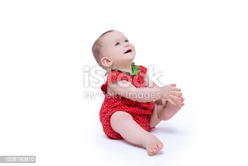 Portrait of cute baby laughing by looking up over white background. Horizontal composition. Studio shot. Image isolated on white.