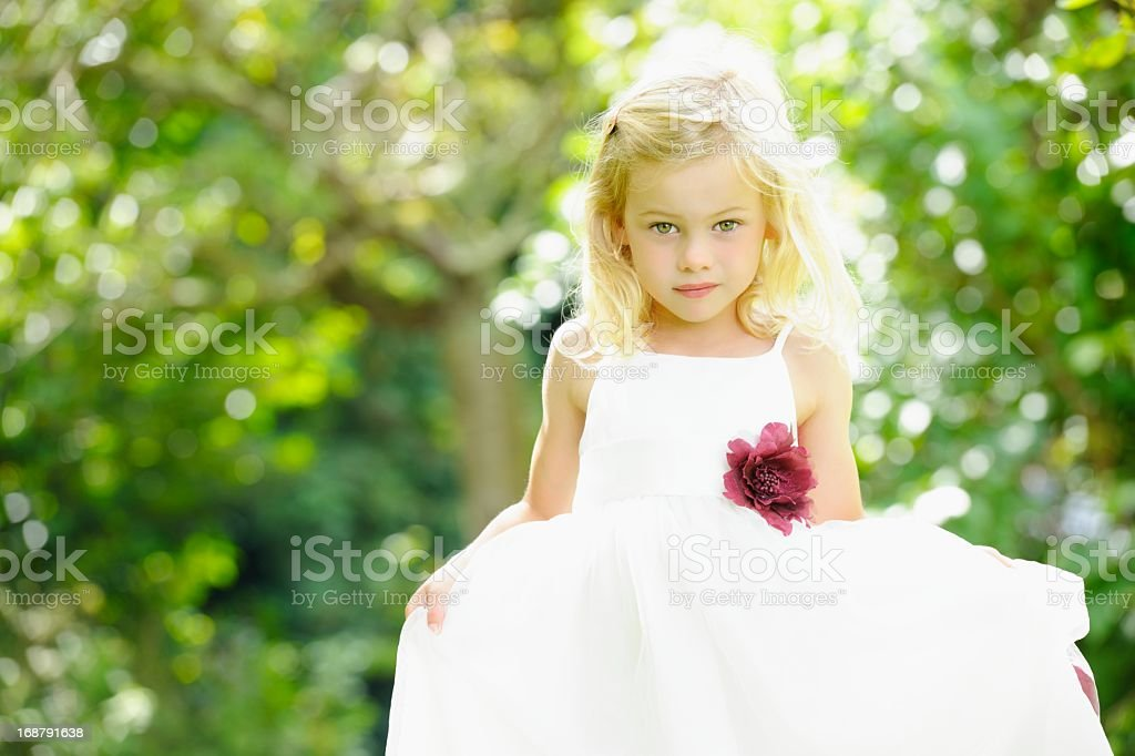 Portrait Of  Cute Caucasian Little Girl/ Bridesmaid In The Garden stock photo