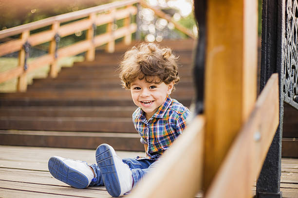 Portrait of cute child sitting on wood stairs – Foto