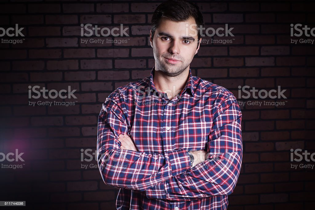 portrait of cute guy in plaid shirt stock photo