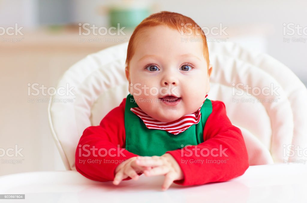 1bfdafdc70ed Portrait Of Cute Infant Baby Boy In Elf Costume Sitting In Highchair ...