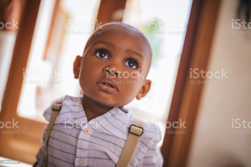 Portrait of cute little baby boy at home stock photo