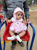 Closeup portrait of cute little baby in park at Mumbai