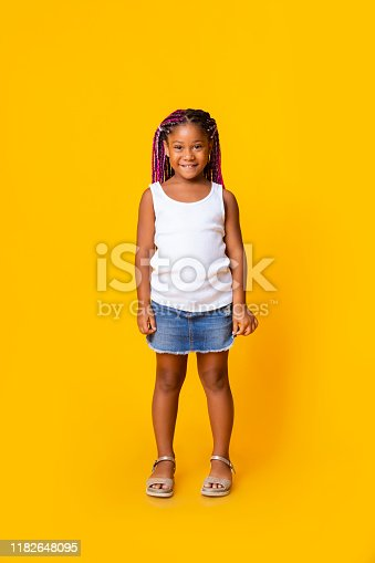 1003539592istockphoto Portrait of cute little black girl with afro braids 1182648095