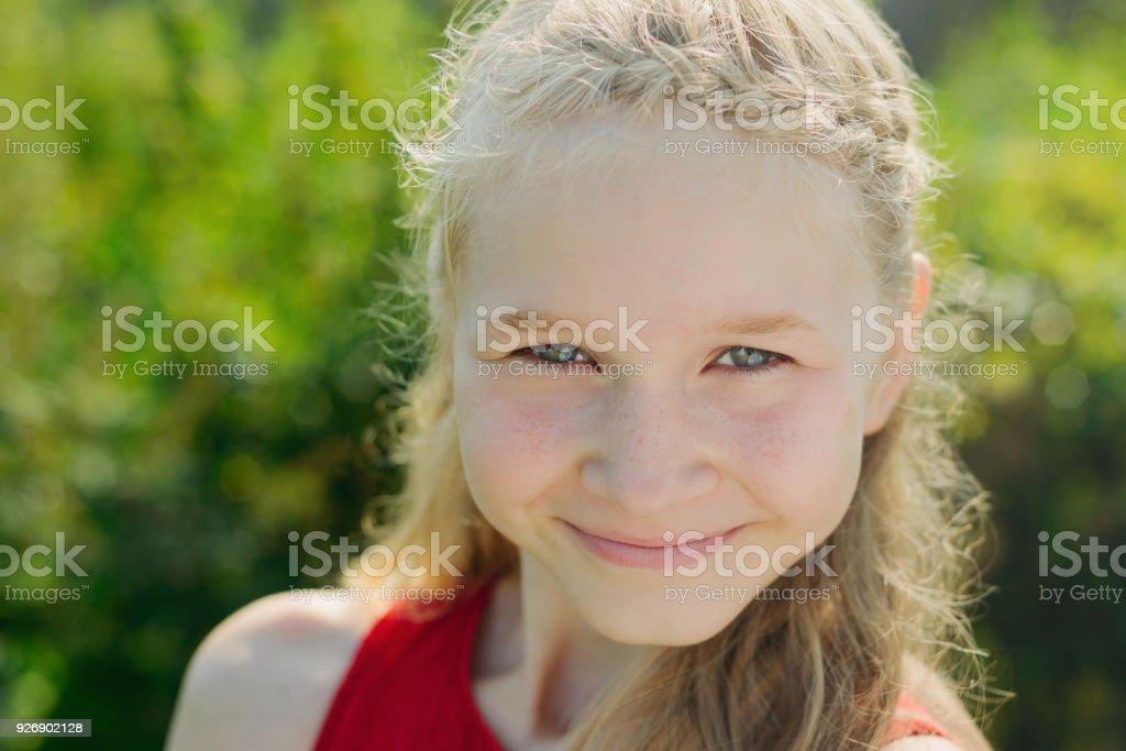 portrait of cute little blonde girl stock photo