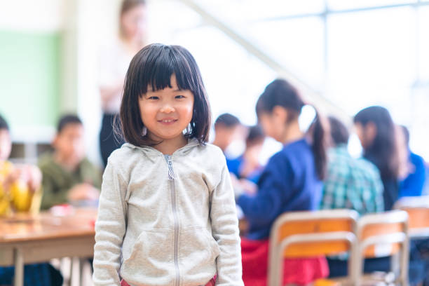 Portrait of cute little girl in classroom A portrait of a cute little girl in classroom. japanese school girl stock pictures, royalty-free photos & images