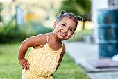 istock Portrait of cute little girl outdoors 1268675212