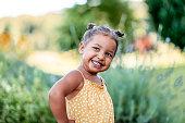 istock Portrait of cute little girl outdoors 1268675353
