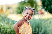 istock Portrait of cute little girl outdoors 1268675353