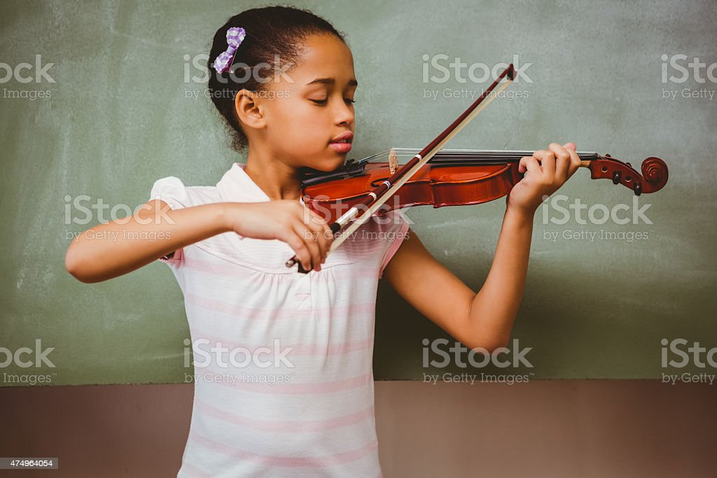Portrait of cute little girl playing stock photo