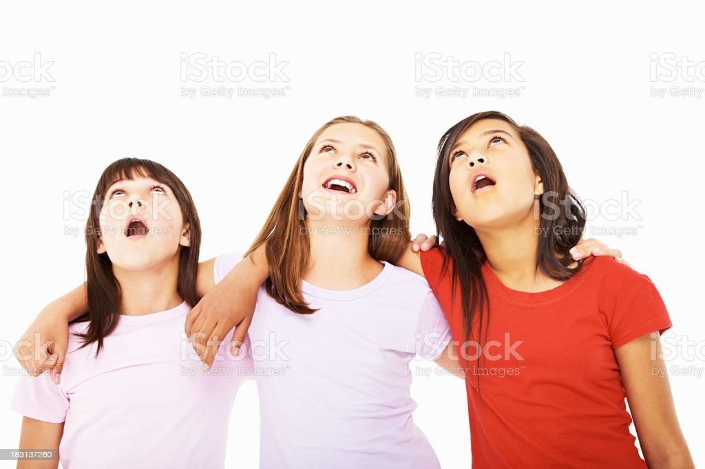 Portrait of cute little girls looking up with curiosity royalty-free stock photo