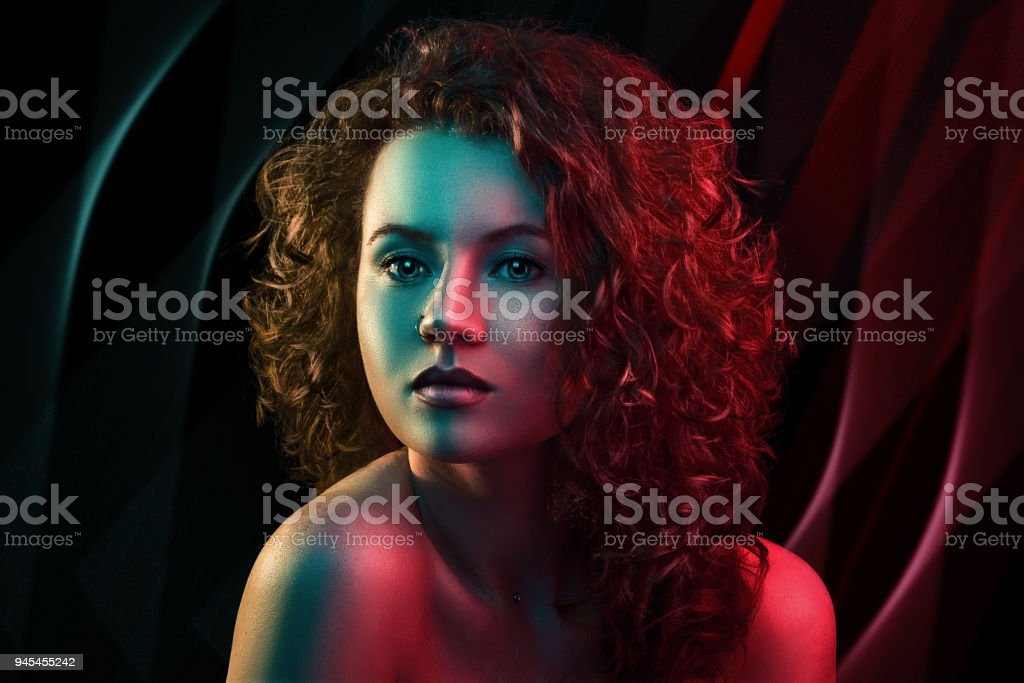 Portrait Of Cute Red Head Girl With Curly Hair In Colorful