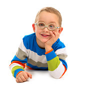 Portrait of cute smiling boy with glasses on a white background\t