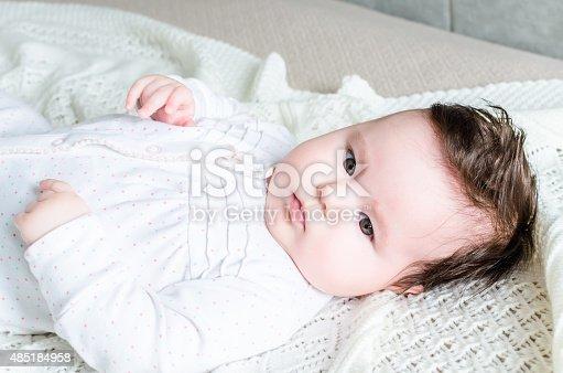 istock Portrait of cute sweet little newborn baby girl 485184958
