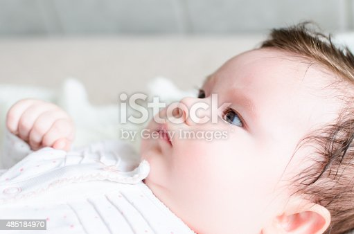 177414958istockphoto Portrait of cute sweet little newborn baby girl 485184970
