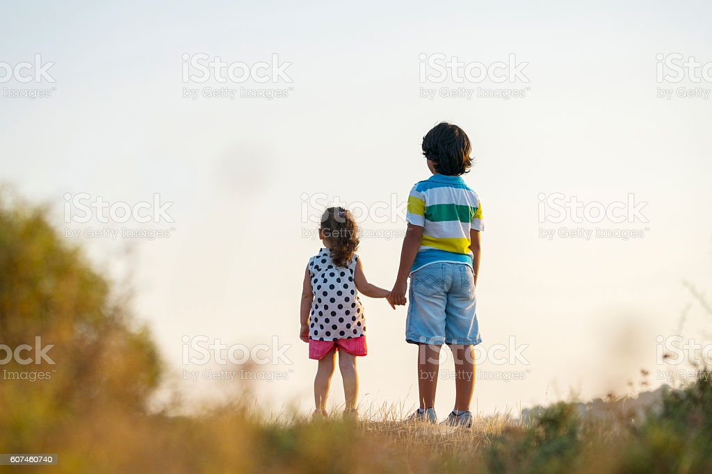 Portrait of cute toddler girl with little boys stock photo