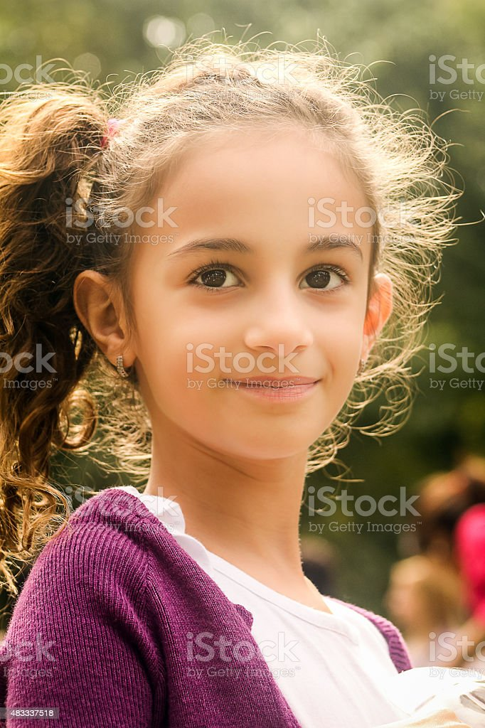Portrait of Cute Young Girl at Park stock photo