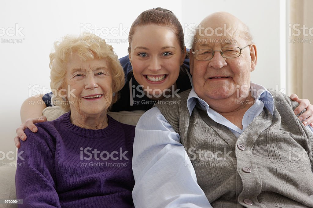 Portrait of cute young girl with older couple royalty-free stock photo