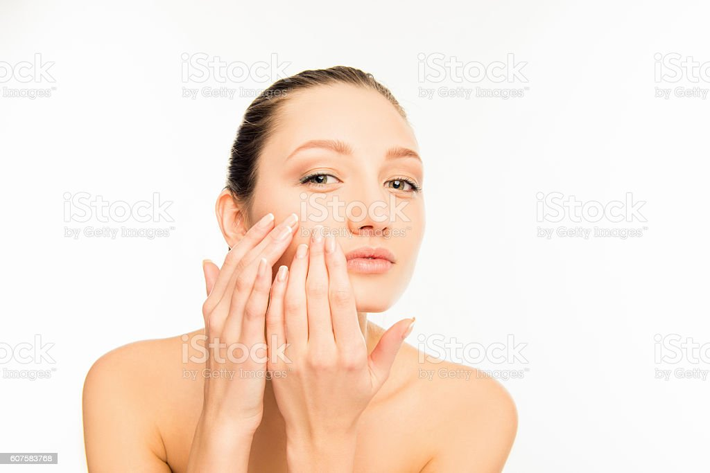 Portrait of cute young lady touching  face stock photo