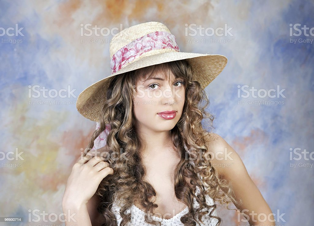 portrait of  cute young woman wearing a straw hat royalty-free stock photo