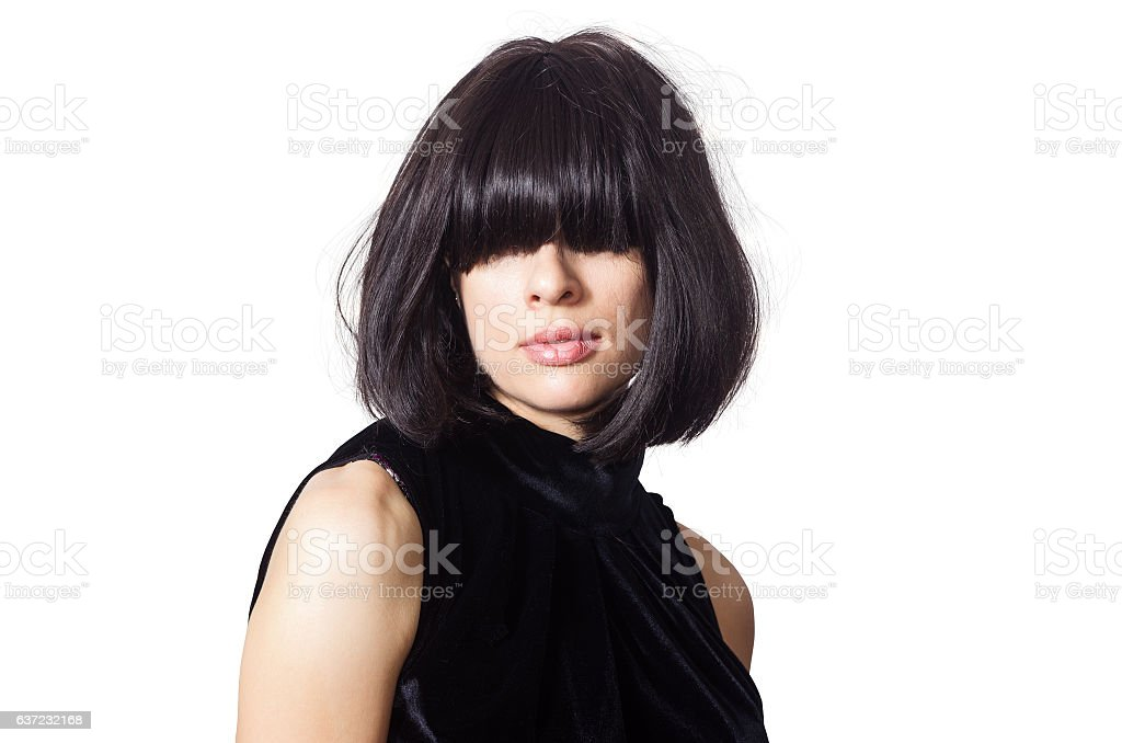 Portrait of dark-haired girl with bangs covering her eyes stock photo