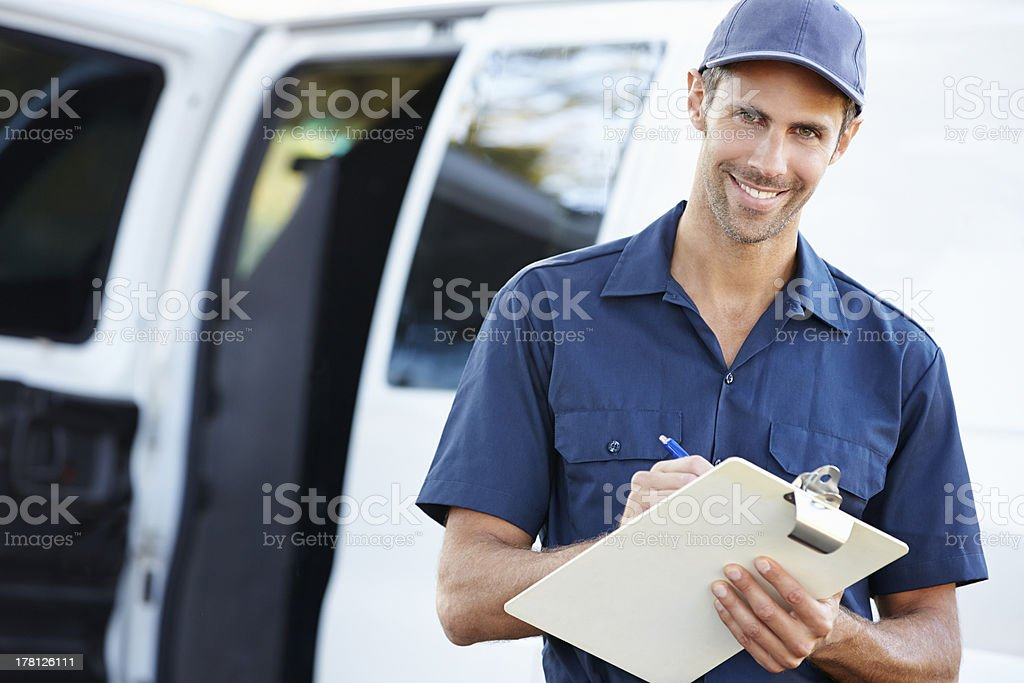 Portrait Of Delivery Driver With Clipboard stock photo
