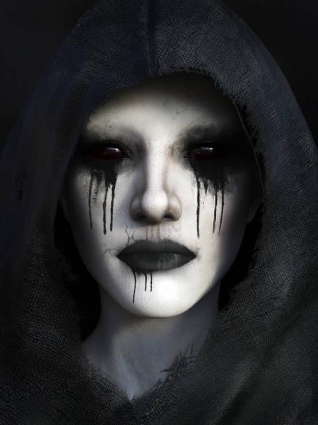 Portrait of demon dressed in a black hood. stock photo