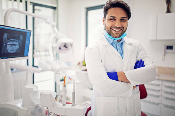 Portrait of dentist in his dentist office stock photo