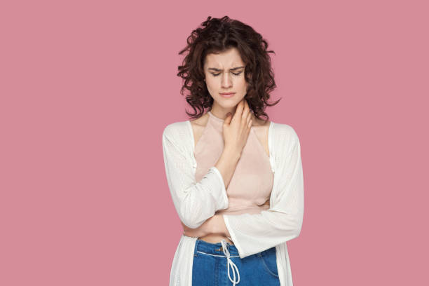 Portrait of depressed beautiful brunette young woman with curly hairstyle in casual style standing, holding her head down and crying. Portrait of depressed beautiful brunette young woman with curly hairstyle in casual style standing, holding her head down and crying. expression, emotion indoor studio shot isolated on pink background nerd hairstyles for girls stock pictures, royalty-free photos & images