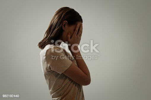932187866istockphoto Portrait of depressed woman, covering face with her hands, side view 932192440