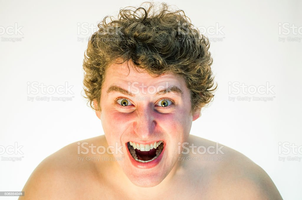 Portrait of devilish, angry, screaming, curly man on white background stock photo