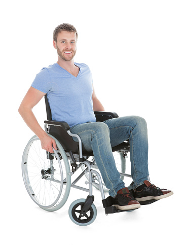 Portrait Of Disabled Man On Wheelchair Stock Photo - Download Image Now